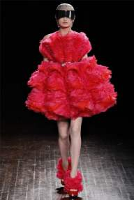 ALEXANDER MCQUEEN: Sarah Burton pushed a new dawn with a collection that started off with white short skirts meant to evoke the idea of a pod and exploding into vivid bright colors of red and magenta silk organza. New life indeed.